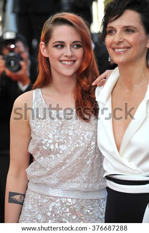 """CANNES, FRANCE - MAY 23, 2014: Kristen Stewart & Juliette Binoche at gala premiere of their movie """"Clouds of Sils Maria"""" at the 67th Festival de Cannes. - stock photo"""