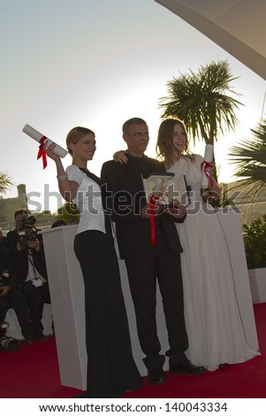CANNES, FRANCE - MAY 26: Lea Seydoux, Abdellatif Kechiche, Adele Exarchopoulos  attend the Palme D'Or Winners Photocall during the 66th Cannes Festival at the Palais on May 26, 2013 in Cannes, France. - stock photo