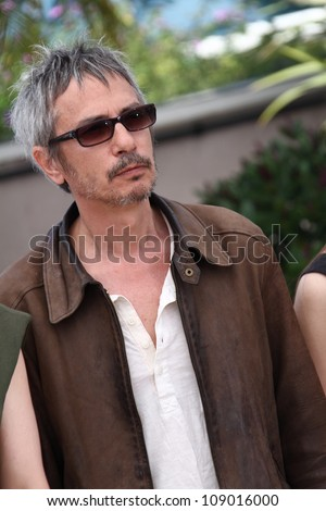 CANNES, FRANCE - MAY 23: Leos Carax  poses at the 'Holy Motors' Photocall during the 65th Annual Cannes Film Festival at Palais des Festivals on May 23, 2012 in Cannes, France. - stock photo