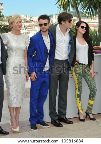 """CANNES, FRANCE - MAY 23, 2012: LtoR:  Kirsten Dunst, Tom Sturridge, Sam Riley & Kristen Stewart at the photocall for their new movie """"On The Road"""" in Cannes. May 23, 2012  Cannes, France - stock photo"""