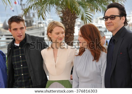 "CANNES, FRANCE - MAY 19, 2014: LtoR: Robert Pattinson, Mia Wasikowska, Julianne Moore & John Cusack at the photocall for their movie ""Maps to the Stars"" at the 67th Festival de Cannes."
