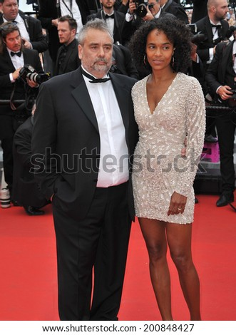 "CANNES, FRANCE - MAY 17, 2014: Luc Besson & Virginie Besson at gala premiere of ""Saint-Laurent"" at the 67th Festival de Cannes."