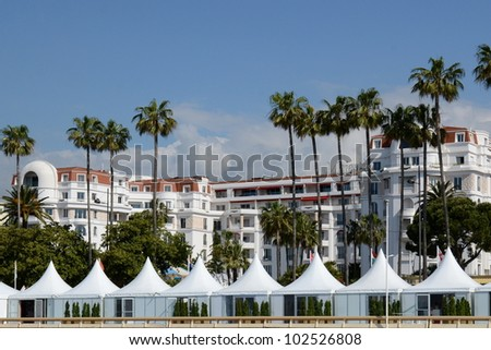 CANNES, FRANCE - MAY 14: Majestic Barriere Palace shown in May 14, 2012 in Cannes, France. Majestic Barriere hotel is a luxury hotel containing 349 rooms, located in the famous festival film town. - stock photo