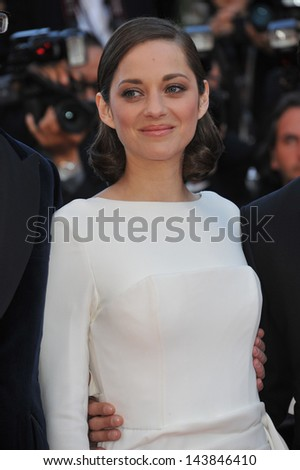 "CANNES, FRANCE - MAY 23, 2013: Marion Cotillard at the premiere of her movie ""The Immigrant"" at the 66th Festival de Cannes.  - stock photo"