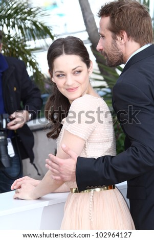 CANNES, FRANCE - MAY 17: Marion Cotillard poses at the 'De Rouille et D'os' Photocall during the 65th Annual Cannes Film Festival at Palais des Festivals on May 17, 2012 in Cannes, France.