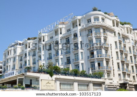 CANNES, FRANCE -  MAY 26: Martinez palace facade shown on May 26, 2012 in Cannes, France. Martinez hotel is a luxury hotel containing 409 rooms, located on the famous festival film town.