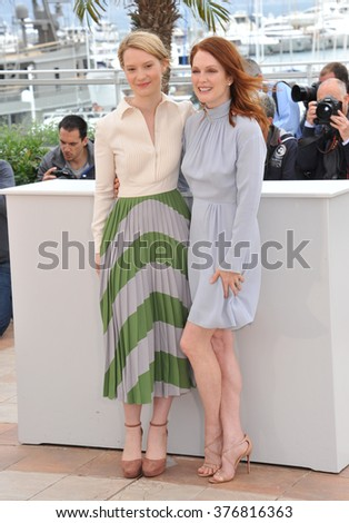 "CANNES, FRANCE - MAY 19, 2014: Mia Wasikowska & Julianne Moore (right) at the photocall for their movie ""Maps to the Stars"" at the 67th Festival de Cannes."