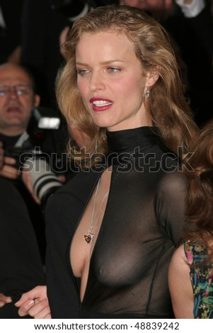 CANNES, FRANCE - MAY 14: Model Eva Herzigova attends a screening of 'Cache' at the Grand Theatre during the 58th International Cannes Film Festival May 14, 2005 in Cannes, France - stock photo