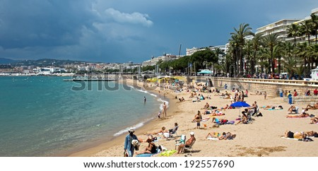 CANNES, FRANCE - MAY 6: People on the most popular beach - Plage de la Croisette on May 6, 2013 in Cannes, France. The famous beach on the Croisette, known for its filmfestival in may.