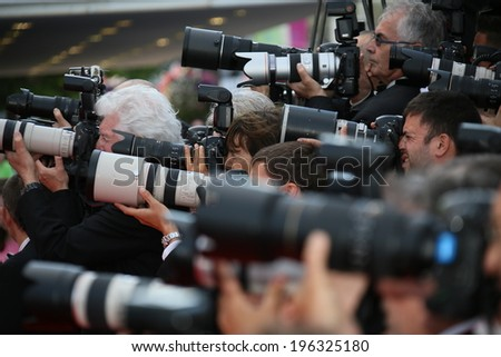 CANNES, FRANCE - MAY 18:  Photographer attends 'The Expendables 3' Premiere at the 67th Annual Cannes Film Festival on May 18, 2014 in Cannes, France.  - stock photo