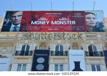 CANNES,FRANCE-MAY 14:Poster shown on Carlton hotel facade on may 14, 2016 in Cannes,France. It is the first time that Julia Roberts comes in Cannes to present a film, Money Monster with George Clooney - stock photo