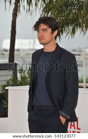 "CANNES, FRANCE - MAY 18, 2013: Riccardo Scamarcio at photocall for his movie ""Miele"" at the 66th Festival de Cannes."