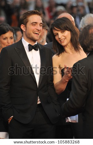 "CANNES, FRANCE - MAY 25, 2012: Robert Pattinson & Juliette Binoche at the gala screening of their new movie ""Cosmopolis"" in Cannes. May 25, 2012  Cannes, France - stock photo"