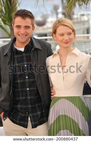 "CANNES, FRANCE - MAY 19, 2014: Robert Pattinson & Mia Wasikowska at the photocall for their movie ""Maps to the Stars"" at the 67th Festival de Cannes."