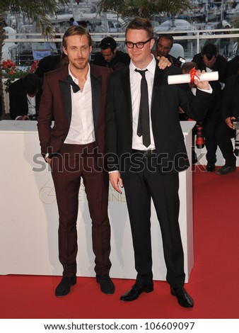 "CANNES, FRANCE - MAY 22, 2011: Ryan Gosling (left) & director Nicolas Winding Refn - winner of the Best Director award for his movie ""Drive""  at the 64th Festival de Cannes awards gala. May 22, 2011 Cannes, France"