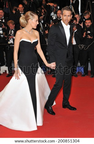 "CANNES, FRANCE - MAY 16, 2014: Ryan Reynolds & wife Blake Lively at the gala premiere of his movie ""Captives"" at the 67th Festival de Cannes.  - stock photo"