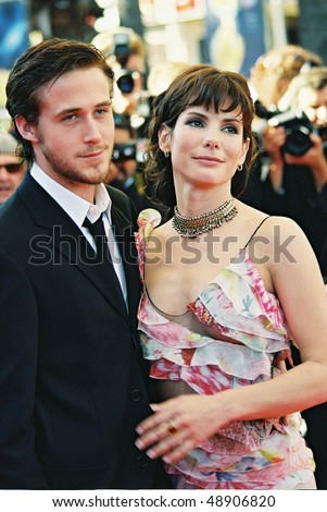 CANNES, FRANCE - MAY 24: Sandra Bullock and Ryan Gosling attend the 'Murder by numbers' Premiere at the Grand Theatre Lumiere during the 55th Cannes film festival on May 24, 2002 in Cannes, France - stock photo