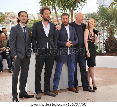 "CANNES, FRANCE - MAY 19, 2012: Shia LaBeouf, Jason Clarke, Tom Hardy, director John Hillcoat & Jessica Chastain at the photocall for ""Lawless"" at the Festival de Cannes. May 19, 2012  Cannes, France"