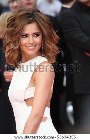 CANNES, FRANCE - MAY 21: Singer Cheryl Cole attends the 'Outside the Law' premiere at the Palais des Festivals during the 63rd  Cannes Film Festival on May 21, 2010 in Cannes, France - stock photo