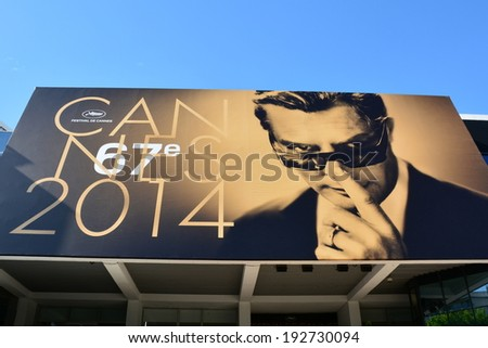 CANNES, FRANCE-MAY 13: the poster for the 67th International Film Festival shown on may 13, 2014 in Cannes, France. This year the artist chosen is the famous  italian actor Marcello Mastroianni. - stock photo