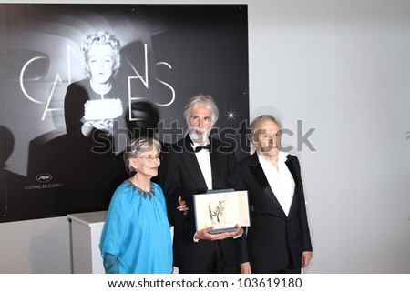 CANNES, FRANCE - MAY 27:  Winners of the Palme  for 'Amour', actress Emmanuelle Riva,  Michael Haneke,  pose at the Winners Photocall during the 65 Cannes  Festival on May 27, 2012 in Cannes, France. - stock photo
