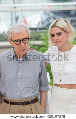 CANNES, FRANCE - MAY 11: Woody Allen and Kristen Stewart attend the 'Cafe Society' photocall, 69th annual Cannes Film Festival at Palais des Festivals on May 11, 2016 in Cannes, France. - stock photo
