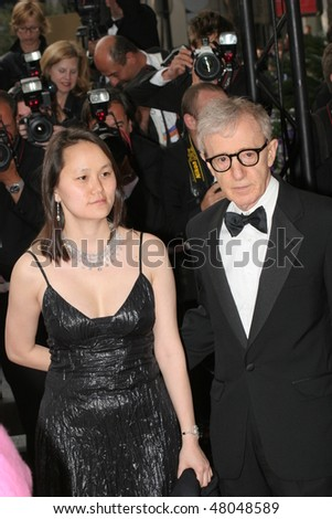 CANNES, FRANCE - MAY 12: Woody Allen and Soon-Yi Previn  attend the premiere of the film 'Match Point' at the Palais during the 58th Cannes Film Festival May 12, 2005 in Cannes, France - stock photo