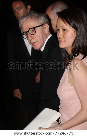CANNES, FRANCE - MAY 11: Woody Allen and wife Soon-Yi Previn  attends the opening night dinner during the 64th Annual Cannes Film Festival at Palais des Festivals on May 11, 2011 in Cannes, France - stock photo