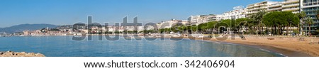 CANNES, FRANCE - NOVEMBER 3, 2003: Panoramic view to embankment and Boulevard de la Croisette on November 3, 2003 in Cannes, Cote d'Azur, France
