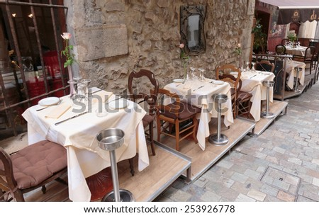 CANNES, FRANCE - NOVEMBER 3, 2014: Street cafe in old town - stock photo