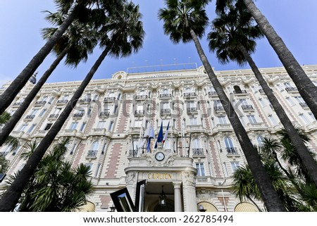 CANNES, FRANCE -SEPTEMBER 8, 2014: Built in 1911, the Carlton is a luxury hotel located on Boulevard de la Croisette in Cannes, France  - stock photo
