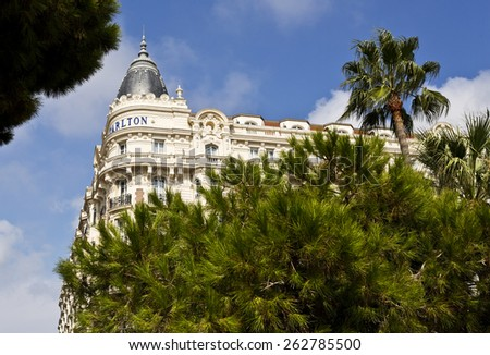 CANNES, FRANCE -SEPTEMBER 8, 2014: The Carlton's distinctive domes on both seaward corners were reputedly designed to resemble the breasts of Caroline Otero the most famous courtesan of the Riviera  - stock photo