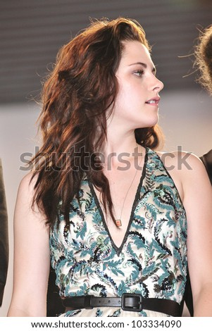 CANNES - MAY 23: Kristen Stewart at the premiere screening of 'On the Road' presented in competition at the 65th Cannes film festival on May 23, 2012 in Cannes - stock photo
