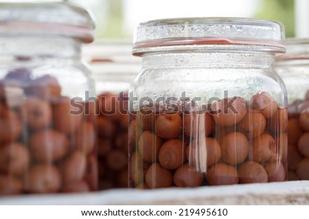 canning fruit canning jars in the kitchen - stock photo