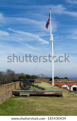 Cannon and Flag at Fort Pulaski next to Tybee island - stock photo