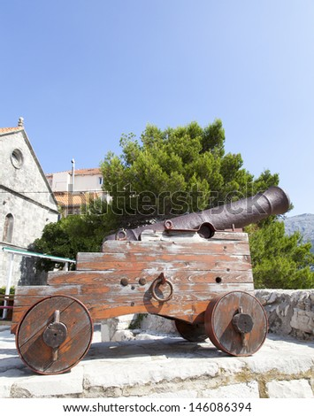 Cannon at old fortress in medieval town Korcula. Croatia, Dalmatia, Space for text - stock photo
