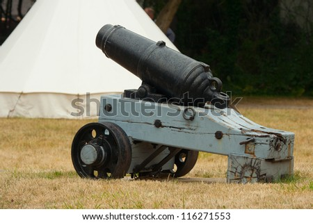 Cannon at the ready for attack. War of 1812 re-enactment