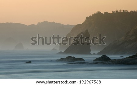 Cannon Beach, Oregon. Looking down the coastline towards Haystack Rock and Hug Point in Arch Cape, Oregon. - stock photo
