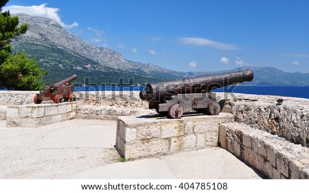 Cannons at medieval fortress in Korcula town, Korcula, Croatia, Europe. - stock photo
