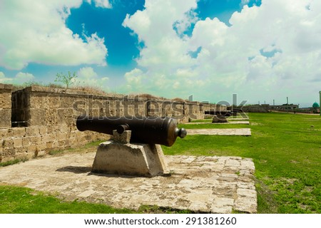 Cannons left by Napoleon Bonaparte troops are in the old fortress city of Acre - stock photo