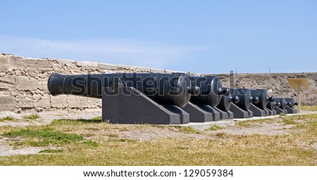 Cannons lined up on the field of the Castillo de San Marcos fort in St. Augustine, Florida. - stock photo