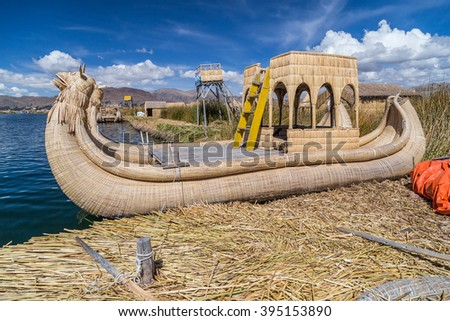 Canoe boat at Uros floating island and village on Lake Titicaca near Puno, Peru - stock photo
