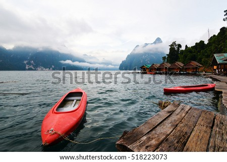 Canoe in a beautiful mountains lake forest and river natural attractions in Ratchaprapha Dam at Khao Sok National Park