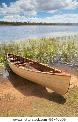 canoe in tropical paradise experience freedom explore and adventure in Mareeba wetlands Queensland Australia tourism in wilderness - stock photo