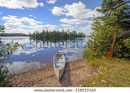 Canoe on Kekekabic Lake in the Boundary Waters - stock photo