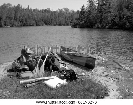 canoe supplies sitting on a boundary waters beach - stock photo