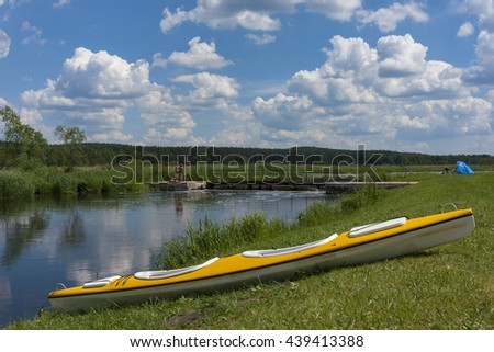 Canoe trip , rest on a river bank - stock photo