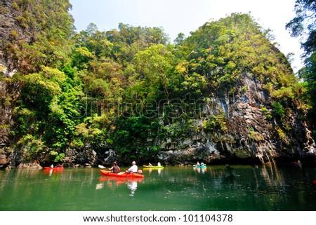 Canoeing in lagoon, Thalane Gulf, Krabi, Thailand - stock photo