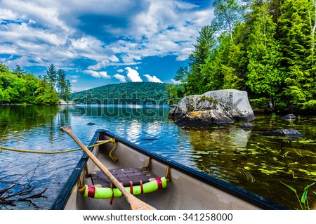 Canoeing on a lake in Quebec, Canada. It created a true Canadian feeling.  - stock photo