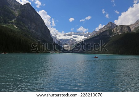 Canoers on beautiful Lake Louise, located in Banff National Park, Alberta, Canada.  - stock photo